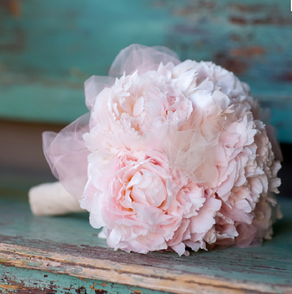 Teal wood and a delicate ballet flower bouquet -- pink peonies and tulle