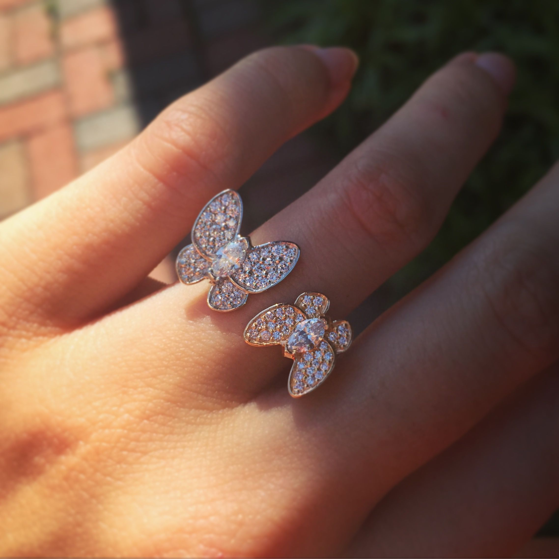 Fly away with this beautiful butterfly diamond ring set in rose