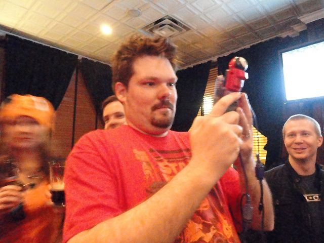 A member of Team Red using the Gameboy camera on the pre-PAX pokecrawl.