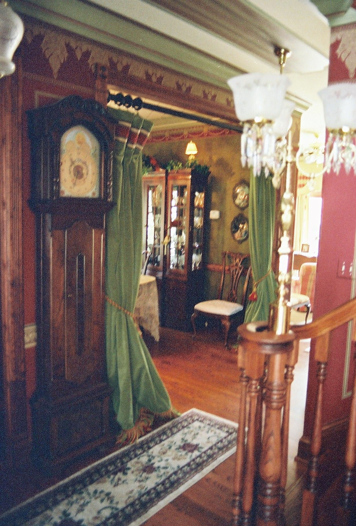 High Victorian Velvet Pole Drapes offer closure to Dining Room.