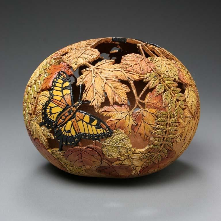 American artist Marilyn Sunderland carves gourds into wonderful works of art, and enhances the etchings with oil and acrylic paints