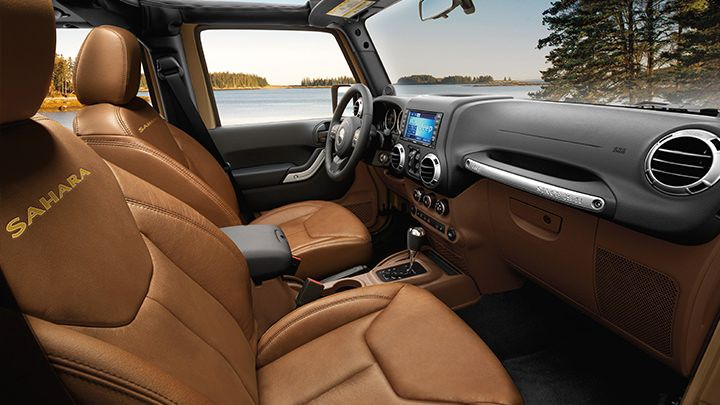 The 2013 Jeep Wrangler Unlimited Sahara Interior Shown In Dark Saddle Auto