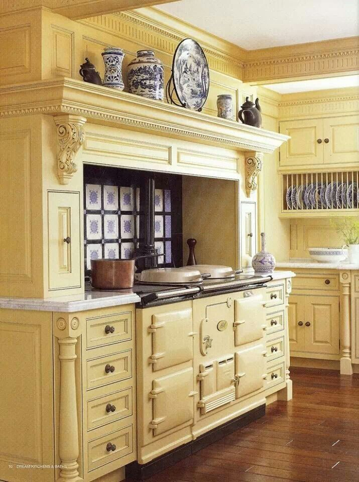 Gorgeous yellow vintage stove, updated with beautiful cabinets...I want!!!!