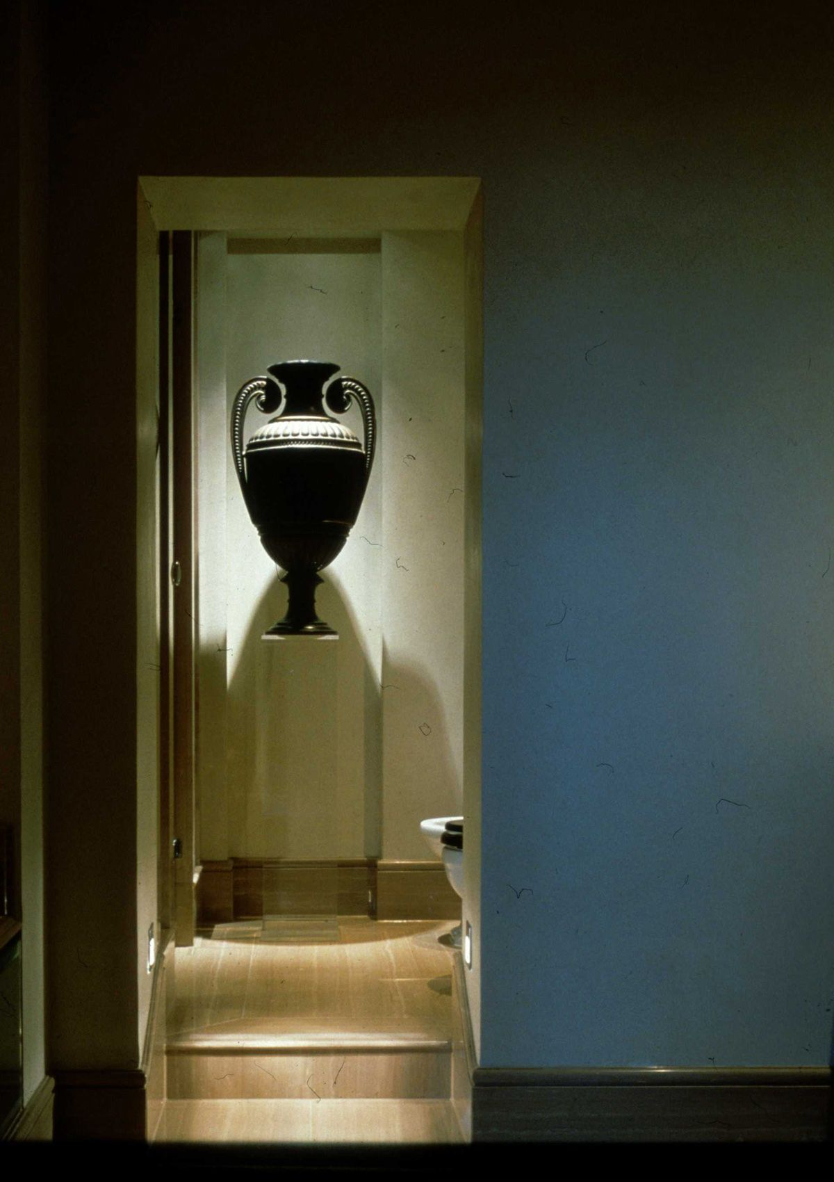 We've used light to accentuate proportions of this classical vase with a Polespring LED downlight and Oslo LED steplights - http://www.johncullenlighting.co.uk/products/interior-lighting/oslo-led/?product_search=oslo