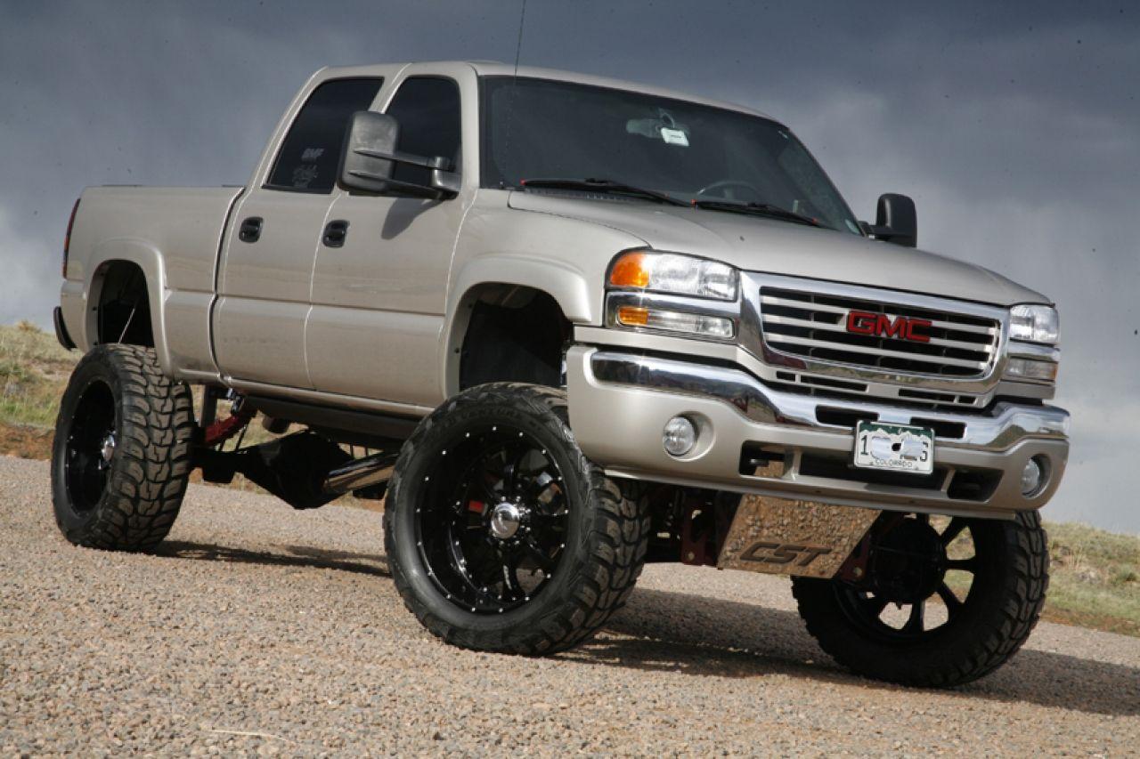 Monster lifted trucks wallpaper lifted silver gmc sierra truck