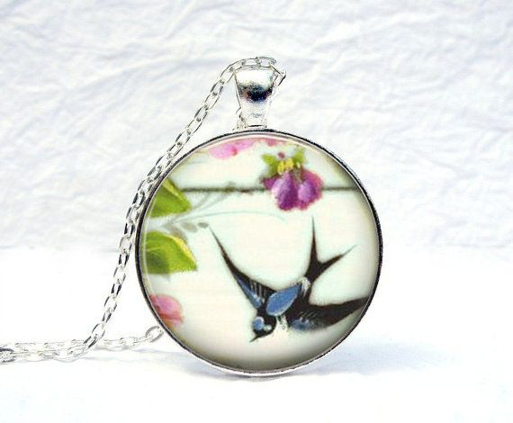 Birds...I'm beginning to like them.Flying Blue Jay Necklace 30mm Glass Dome Silver by KaDishDay, $18.00