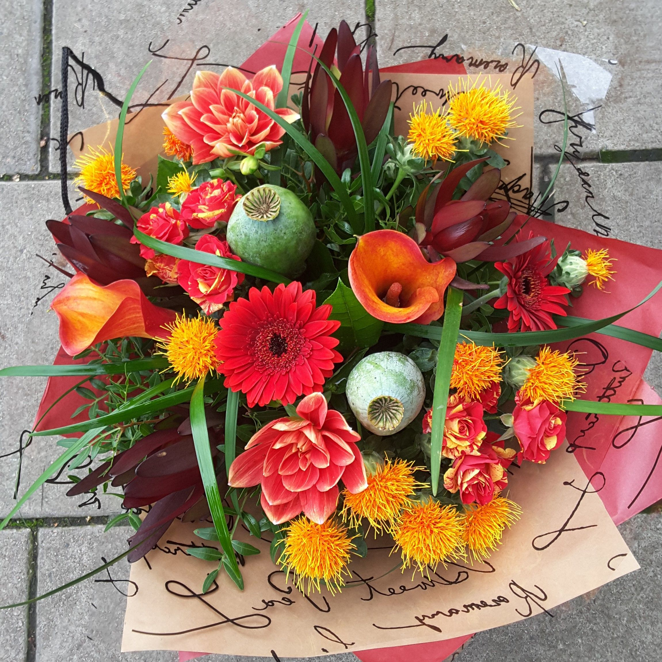 Autumn bouquet in bright oranges and reds. Florist