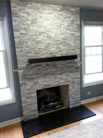 A contemporary fireplace in El Capitan Gray Blend. The black ...