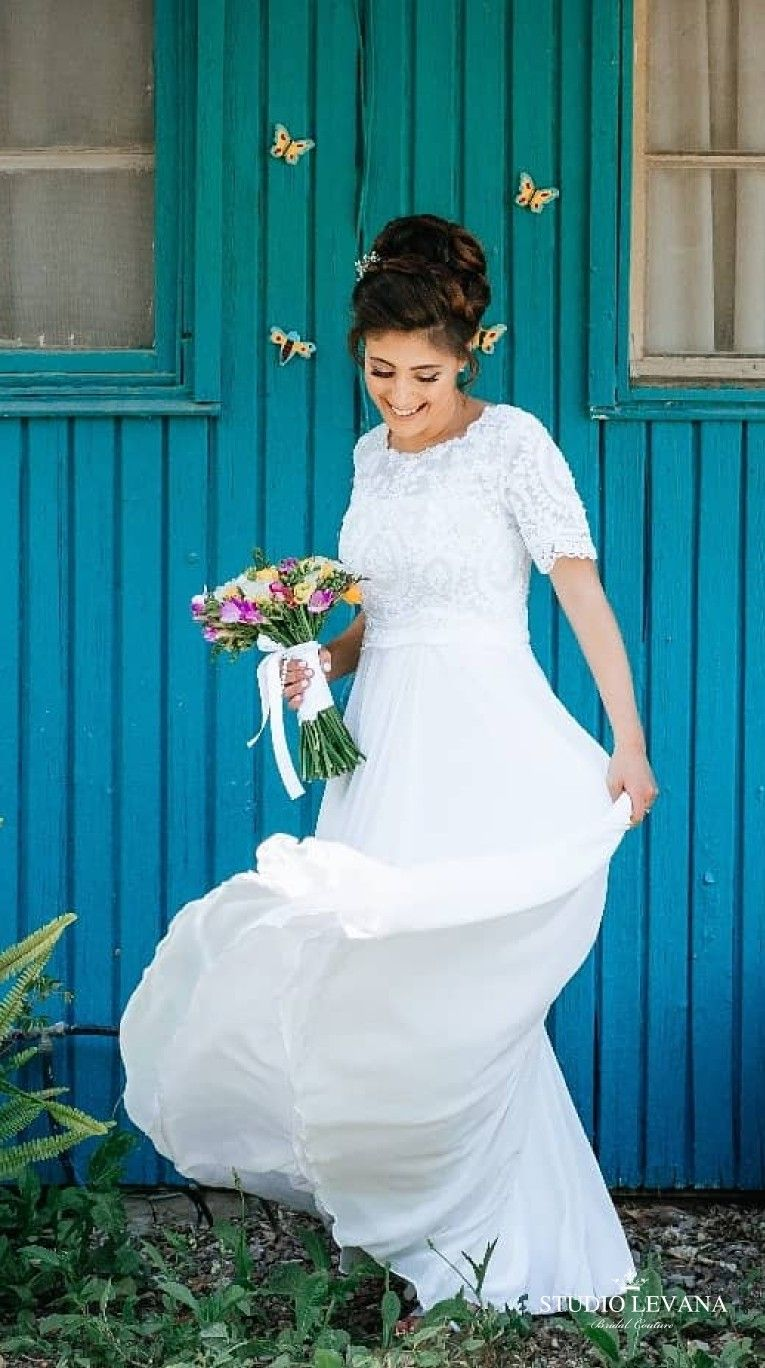 Real modest bride in a modest bridal gown with short sleeves from ...