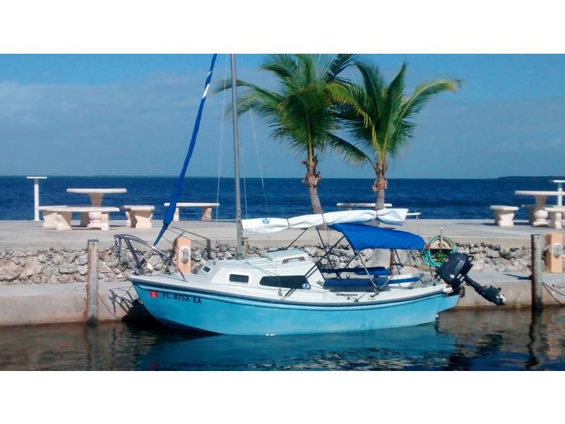 1984 West Wight Potter, a 15 foot pocket cruiser with Bimini