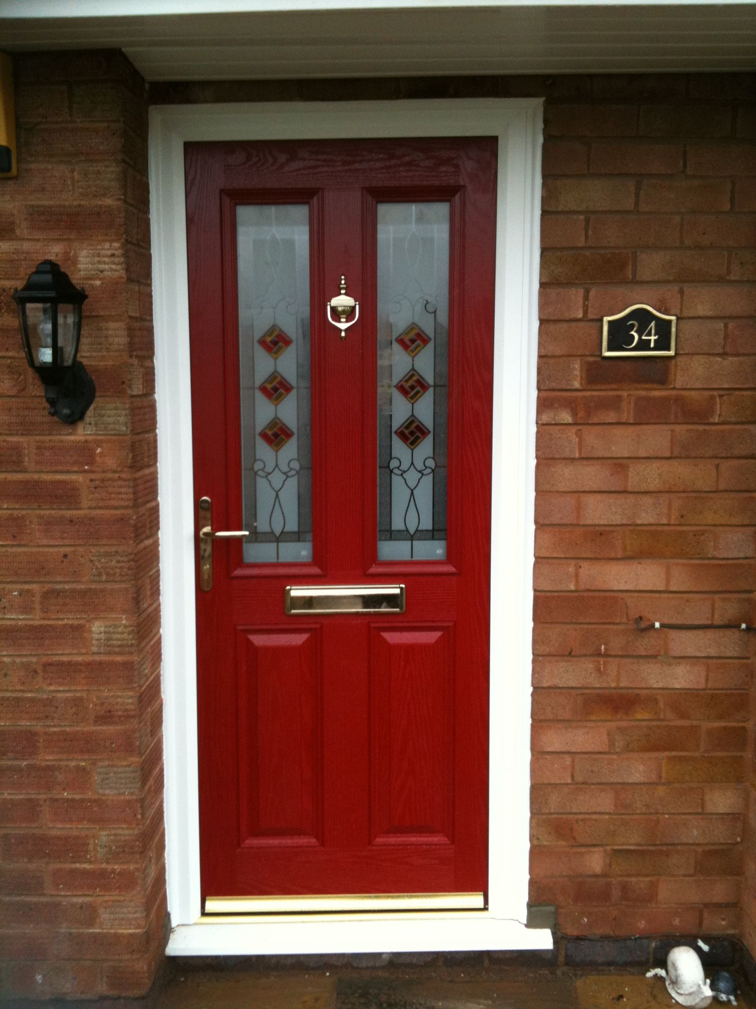 Red Composite Door In A White Upvc Frame Installed By