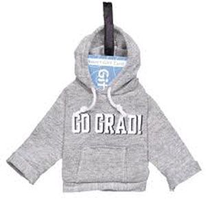 "Our Way to Go Grad Graduation Gift Card Holder is the perfect way to give the gifts that keep on giving! This snappy gray hoodie shaped gift card holder features a white ""Go Grad"" printed headline. Gift card holder is perfect for your graduation gift. Holder fits any standard sized gift card and measures about 7in x 7in."