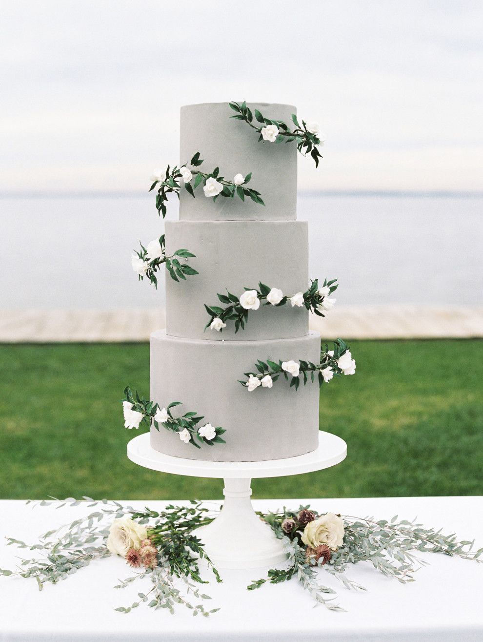 Wedding decoration ideas in kerala  Gray cake with delicate sprigs of flowers and greens Created by