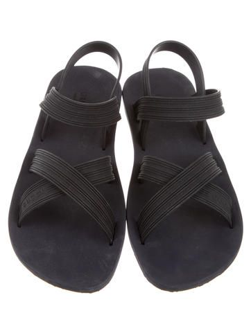 5c85c5c54421 Men s blue and black Gucci rubber sandals with crisscross straps and GG  monogram soles. Designer size 10.5