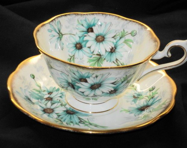 ROYAL ALBERT AVON GOLD MARGUERITE DAISY TEA CUP AND SAUCER