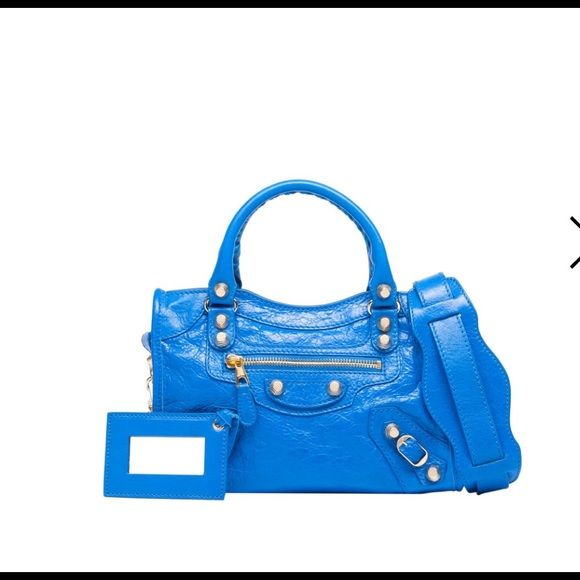 Nwt balenciaga mini city Over-The-Shoulder Blue Leather Handbag with Removable Shoulder Straps ; Gold hardware ; External zip pocket ; Removable hanging leather frame mirror ; Hand stitched handles mini city Balenciaga Bags Satchels