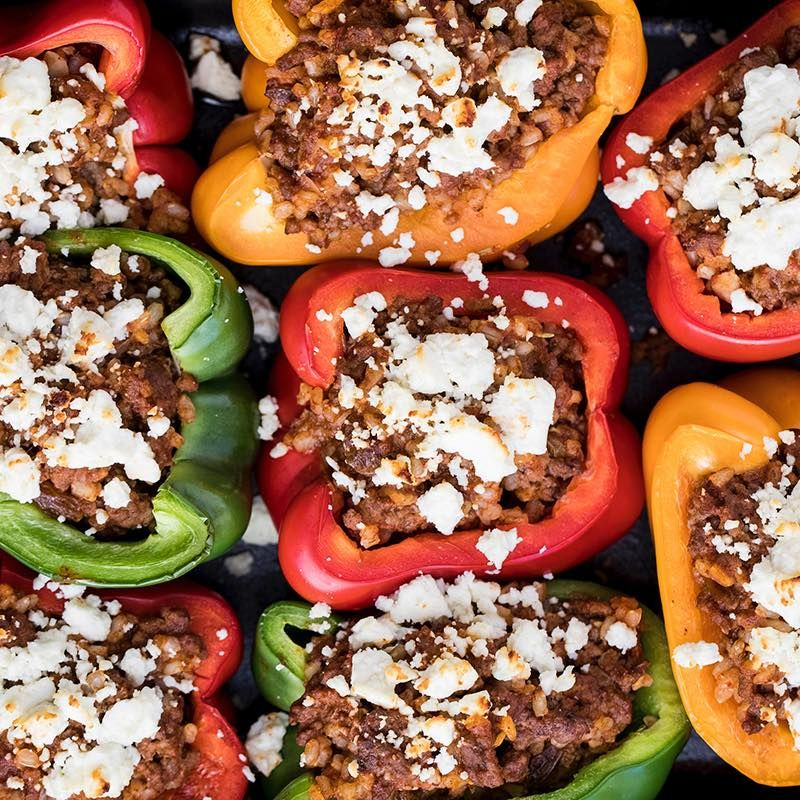 The Delicious Stuffing Features Ground Beef Brown Rice Golden Raisins And Almonds Seasoned With A Flavorful Supe Stuffed Peppers Recipes Food Network Recipes