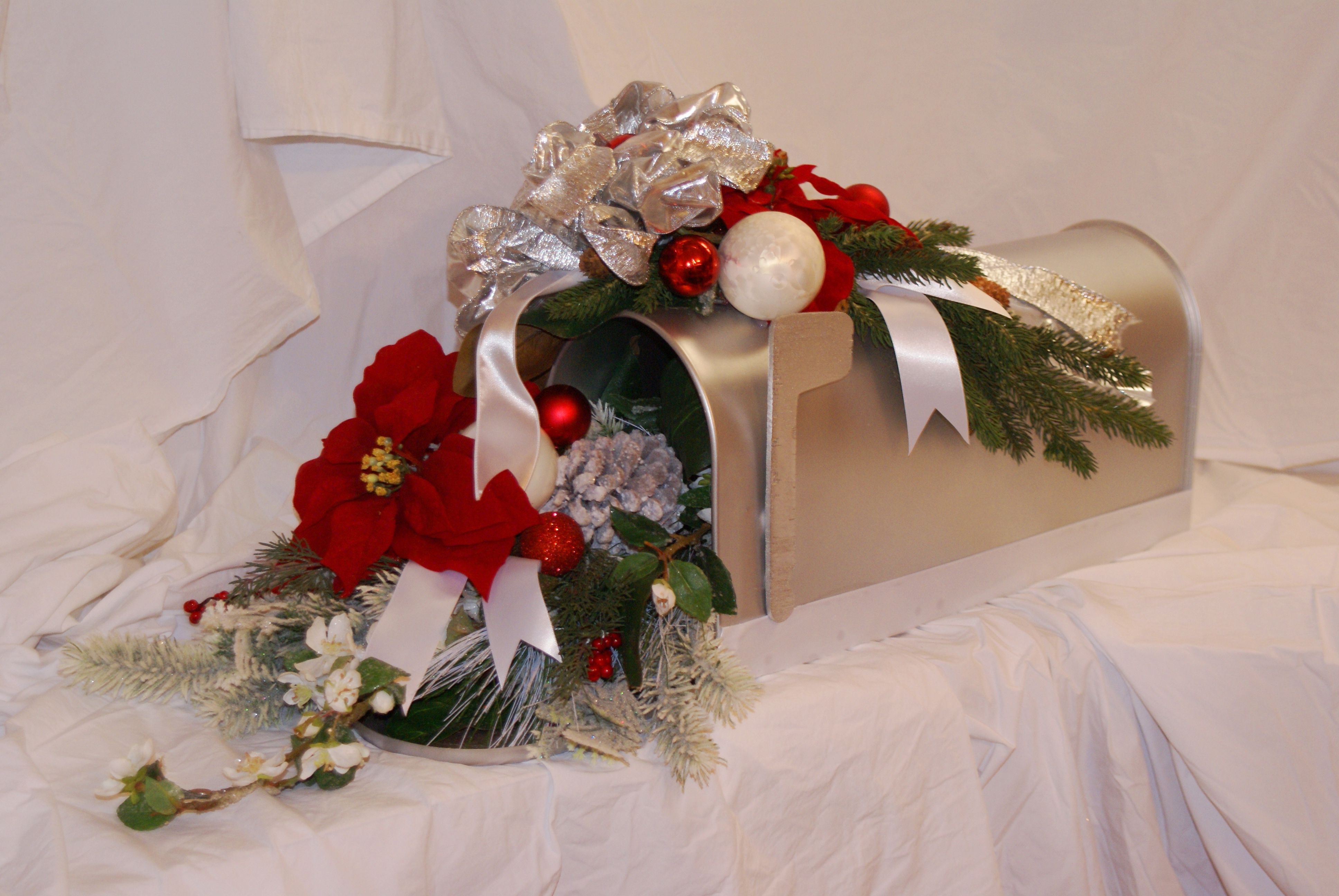 Dress up an old mailbox with a fresh coat of paint, Christmas greens and sparkly ornaments for a tabletop display