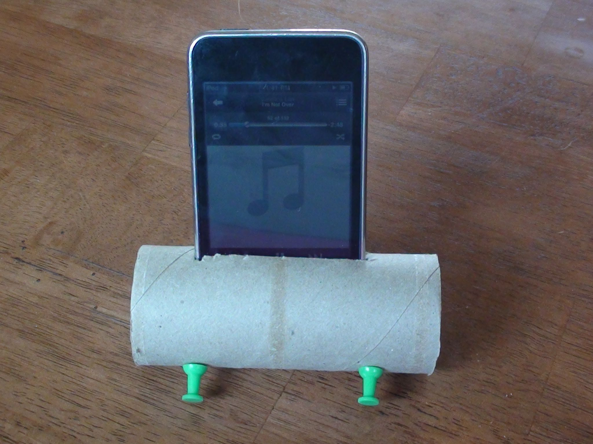Make your own IPOD speaker amplifier using a toilet paper roll and some pushpins to keep it from rolling.  It really works if you have external speakers