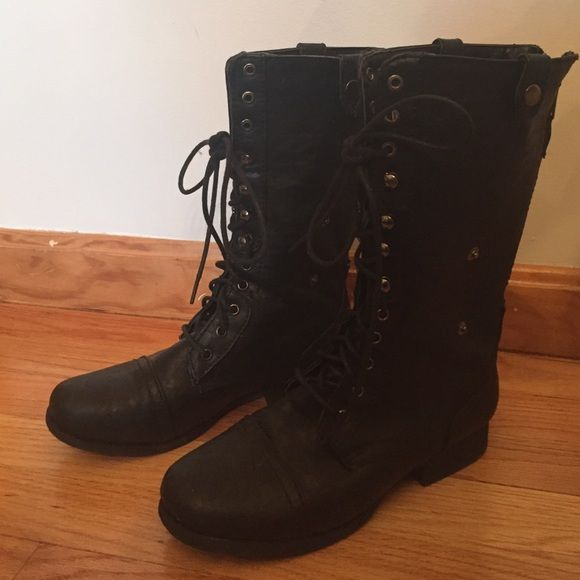 Black combat boots Black combat boots that can be laced up or folded over to show off the black and white aztec print on the inside! Charlotte Russe Shoes Combat & Moto Boots