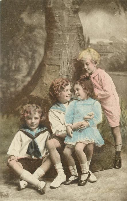 untitled: three boys & a smaller girl sit posed with two boys to left, girl sits on boy's knee & looks into his eyes