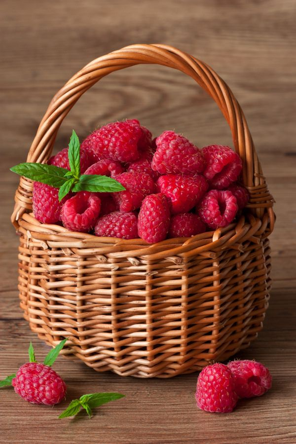 Fresh Raspberries on a wicker basket.