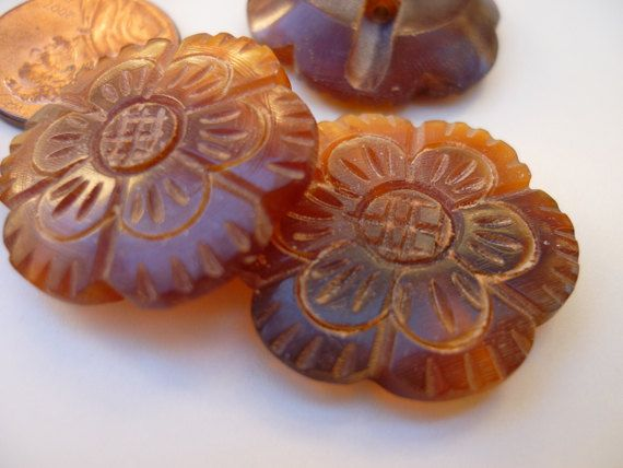 Carved horn buttons