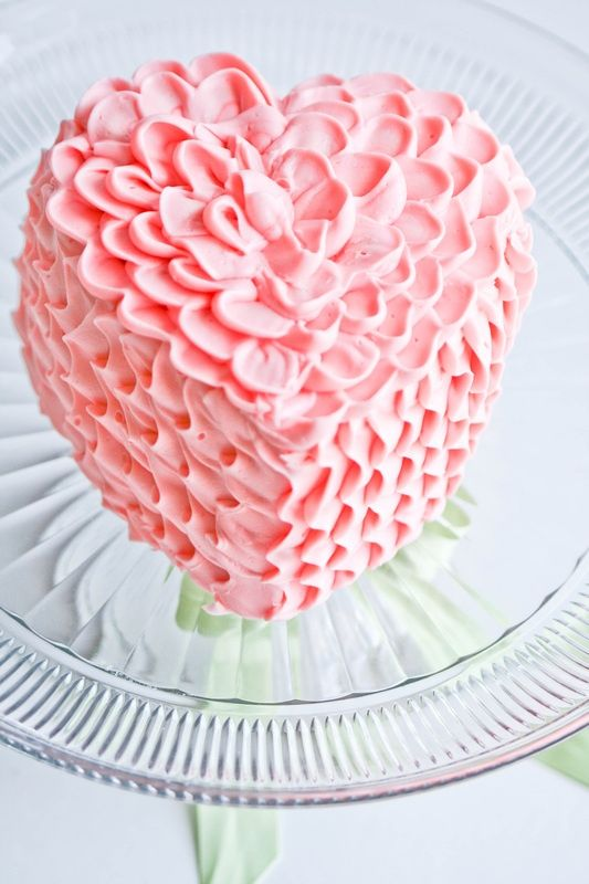 It's pink, sweet, gooey, spongy, delicate ,  festive, just the perfect size for 2, symbolic, cute & yummy. I Heart this cake...I do  I do  I do