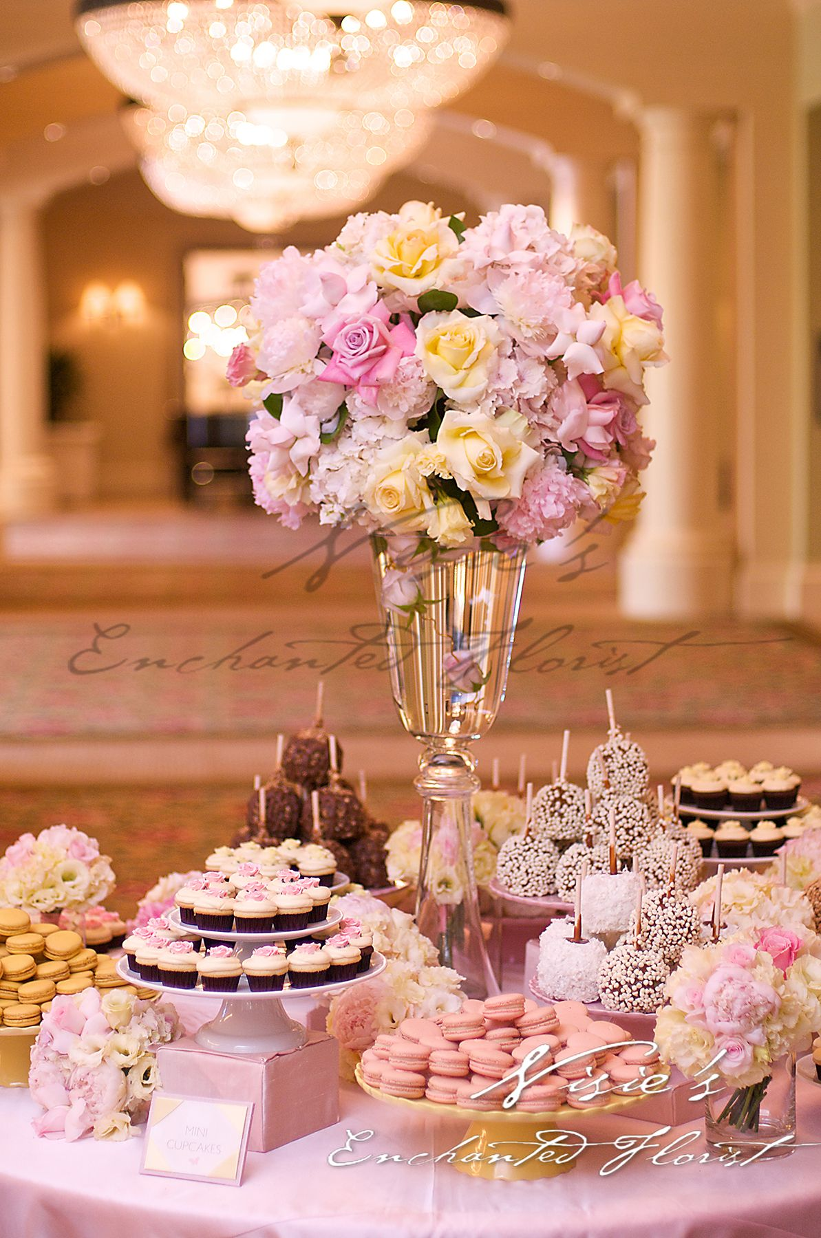 A wedding beautiful flowers macaroons candy apples