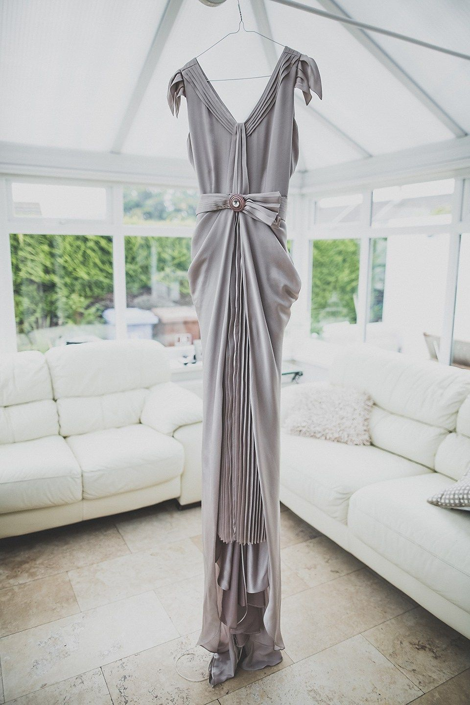 Tara wore a pleated dress in silk with a floral veil for her beautiful coastal wedding at Cushendall Golf Club in Northern Ireland. Photography by Mary McQuillan.