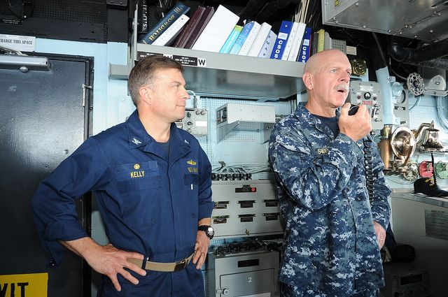 PHILIPPINE SEA (May 28, 2013) Commander, U.S. 7th Fleet, Vice Adm. Scott H. Swift, right, discusses fleet operations with the crew aboard the Ticonderoga-Class Guided-Missile Cruiser USS Chosin (CG-65) over the ships intercommunication system along side Chosin Commanding Officer Capt. Patrick Kelly during a ship visit.