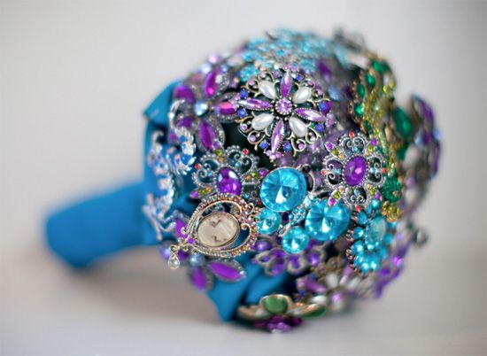 David Tutera showed it and the world seems to have grasped it!  Brooch wedding bouquets...  This one is peacock inspired and what a fanciful arrangement!