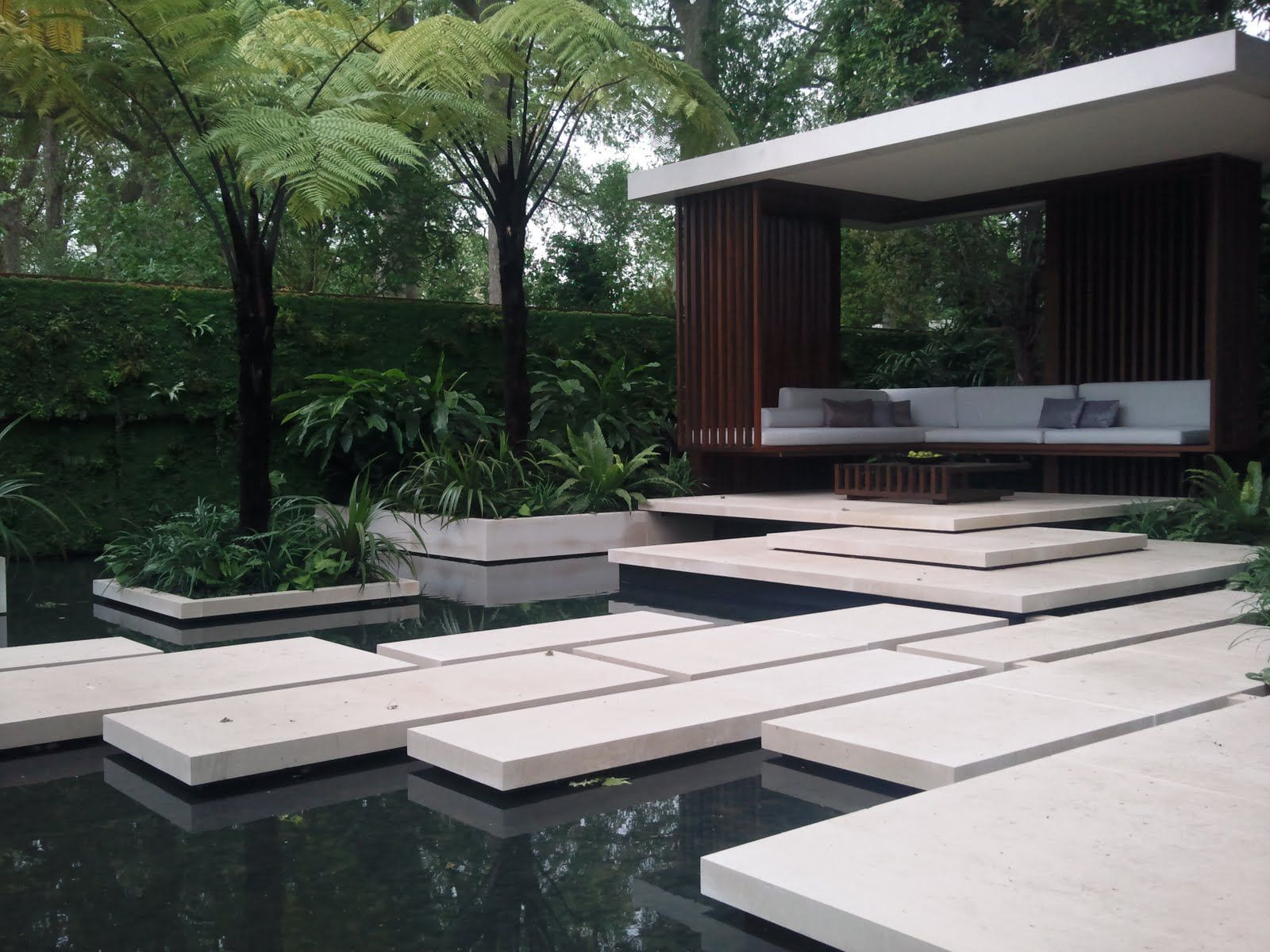 Pond with stepping stones and seating area jamieson for Modern garden pond designs