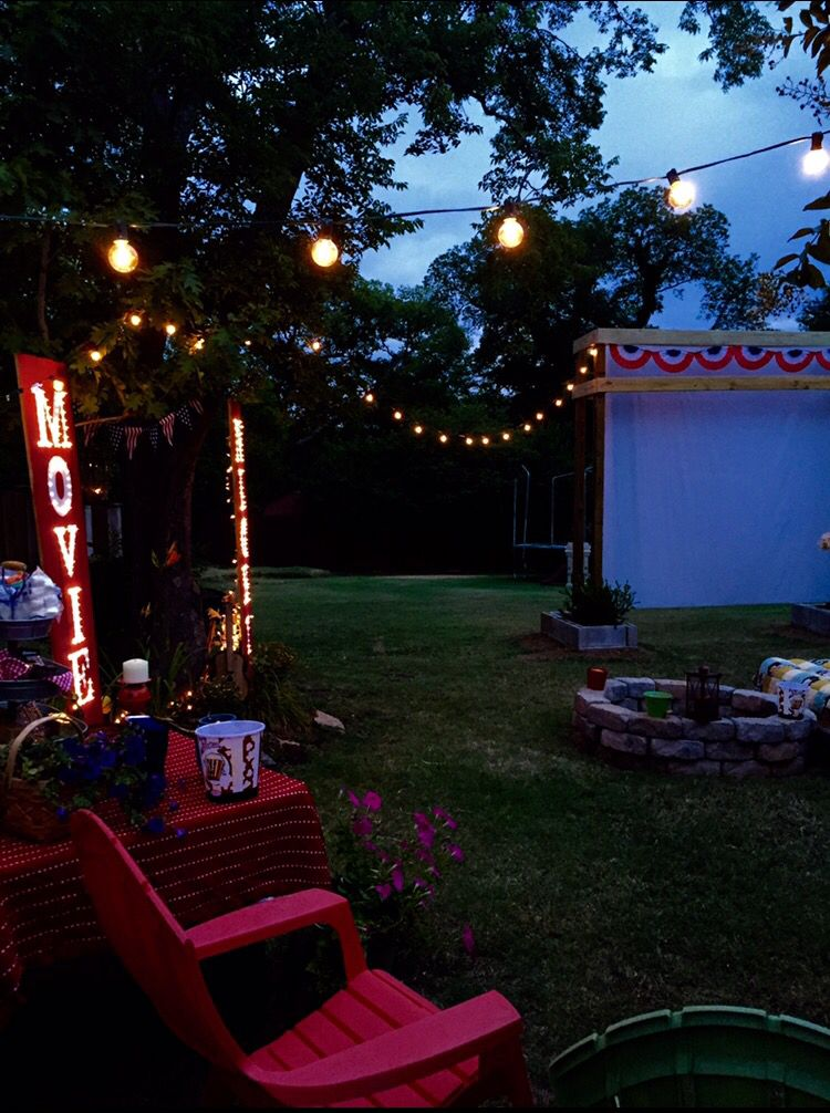 Outdoor movie screen and sign backyard movie screen