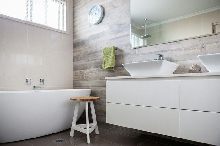 bathroom renovations, white ceramic tub, white cupboard with two ...