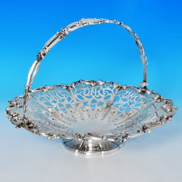 Those homemade goodies are going to look enticing served in this delightful pierced  silver basket.