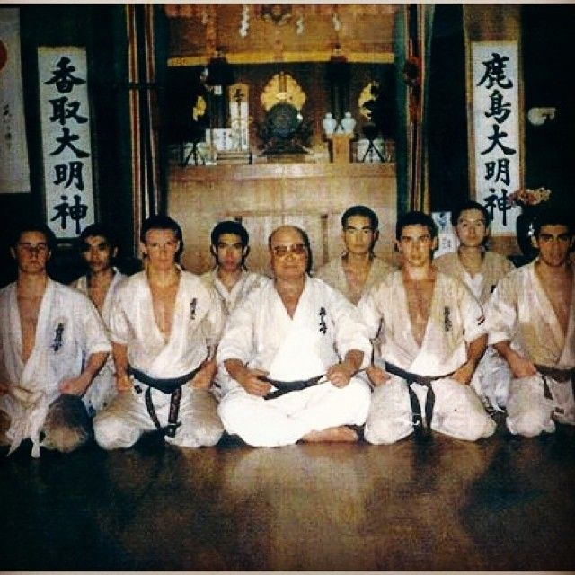 "Judd Reid trained at the Kyokushin Karate honbu in Japan as an ""uchi deshi"" under Sosai Masutatsu Oyama from 1990-1993. ""Uchi deshi"" means live in student and in Kyokushin Karate it was a 1000 day program of training all day every day. The few students chosen to enter the program were known as the ""wakajishi"" or young lions.  The Kyokushin Karate honbu dojo is located in Ikebukuro in Tokyo and this photo is of Sosai and his young lions taken inside the honbu in 1990.  Watch Journey to the…"