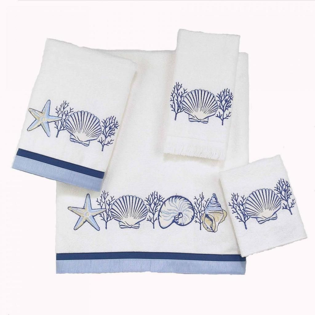 Bed bath and beyond bath towels - Blue And White Embroidered Seashells Adorn This Set Of Coastal Inspired Bath Towels Complete