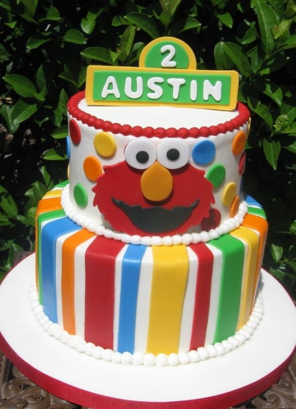 Cute Sesame Street Cake With Stripes Then Elmo And Cookie Monster Toys On Top A 2