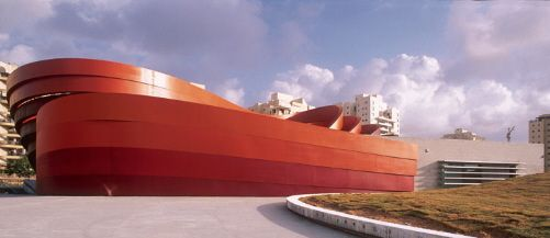 Design Museum in Holon, Isreal-- one of the world's leading museums of design and contemporary culture.  An iconic building by the internationally acclaimed architect, Ron Arad--he is considered to be one of the world's top five architects,  the museum has won the Conde Nast Traveller Innovation and Design Award. Made of  striking red and orange steel , it opened in March 2010.