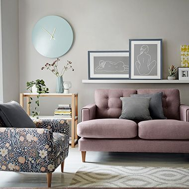 Floral Print Armchair And Pink Sofa In Modern Living Room In