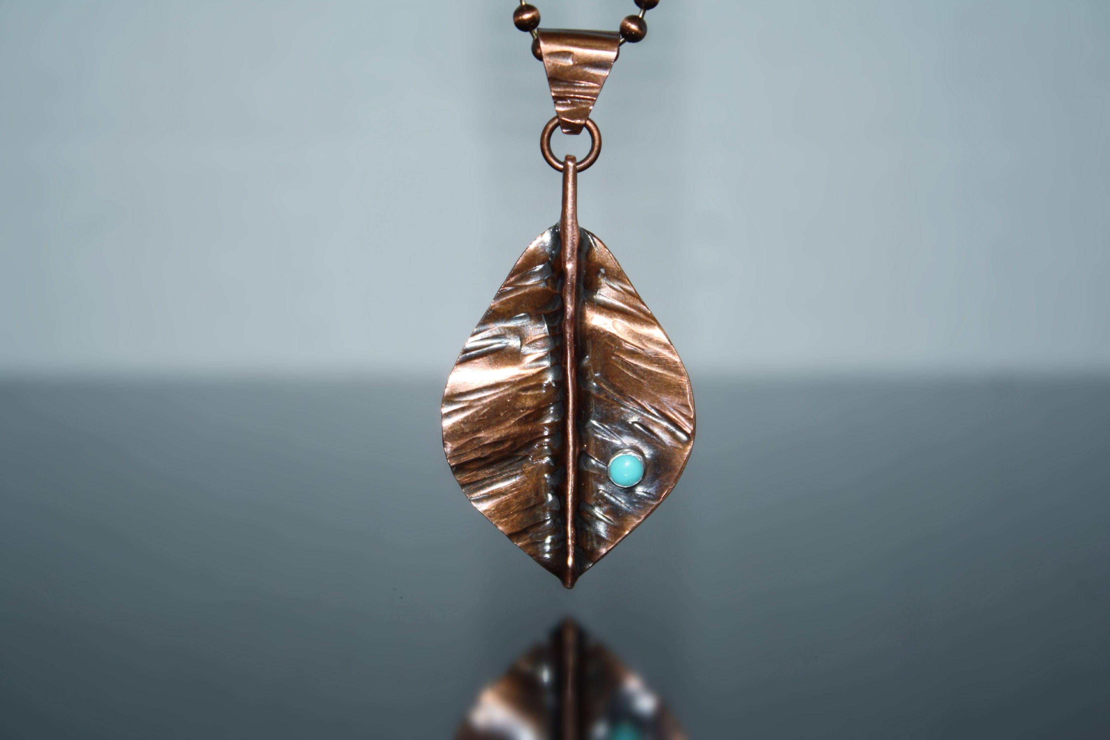 Copper turquoise leaf pendant.