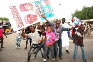 Supporters of presidential candidate Muhammadu Buhari and his All Progressive Congress party celebrate in Maiduguri