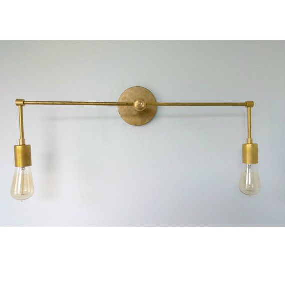 With its two lights and elongated shape the magazine sconce would the magazine double sconce double light sconce brass sconce brass bathroom light modern sconce minimalist sconce aloadofball Choice Image