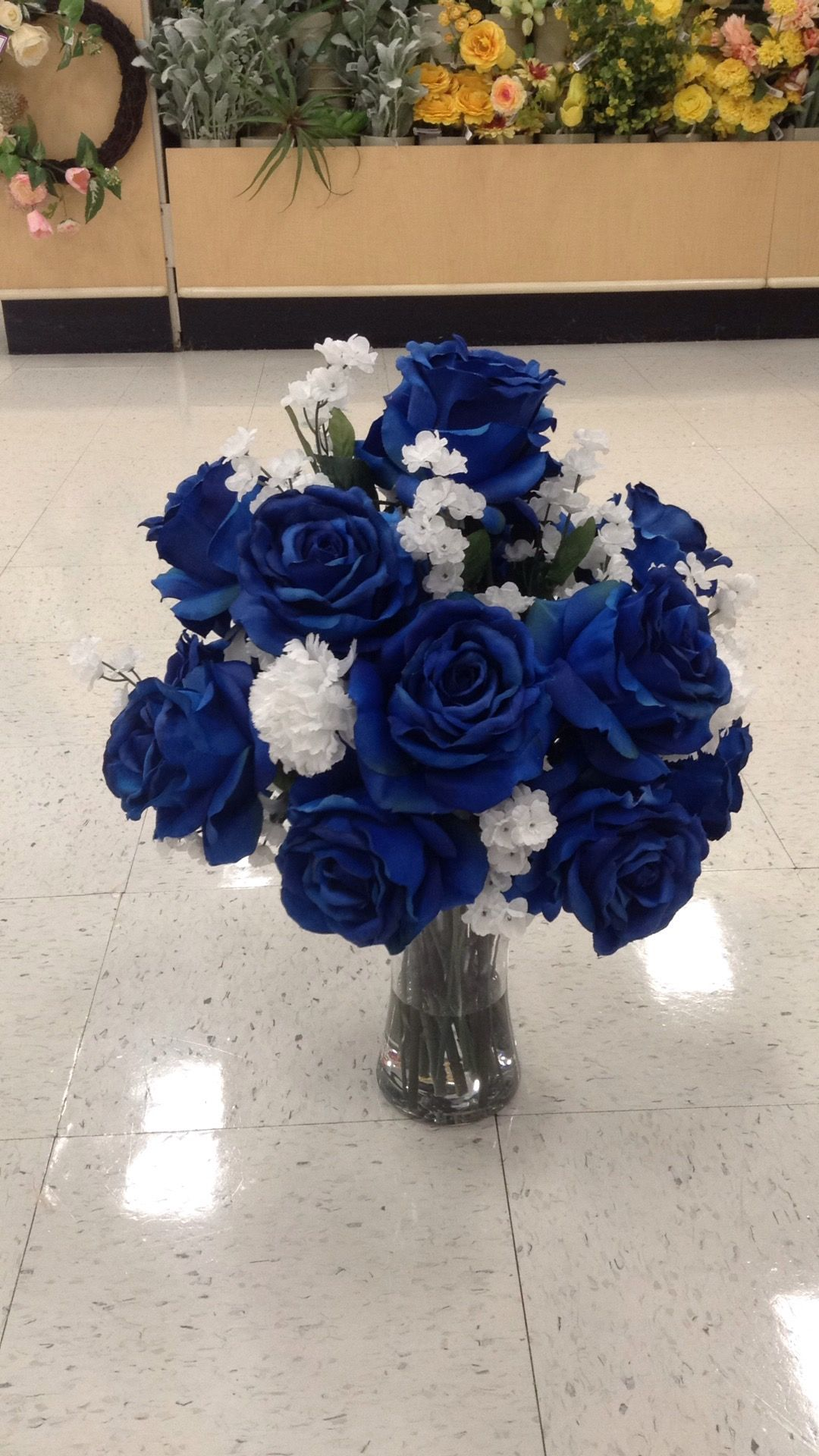 Custom Floral Arrangement Of Navy Blue Roses With White Baby S Breath And Carnations In A Flared Gla Blue Flower Arrangements Blue Carnations Rose Arrangements