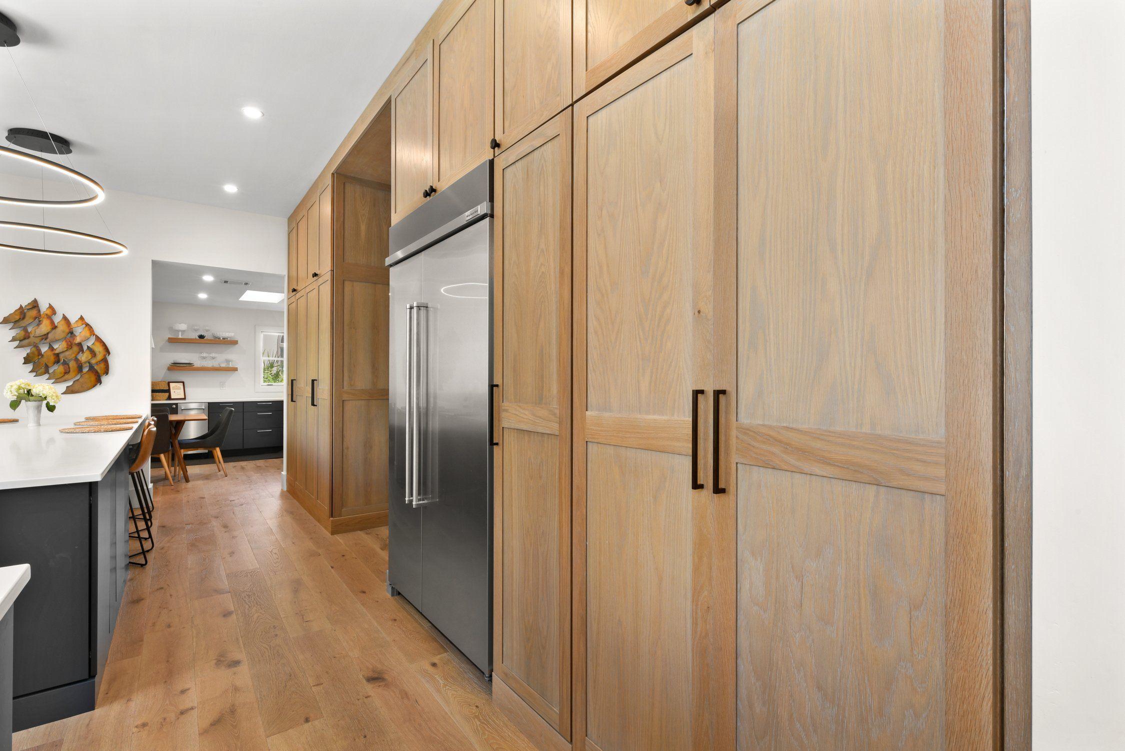 Modern Kitchen Slab Shaker Featuring Wall Of White Oak Oak Floating Shelves White Oak Kitchen Slab