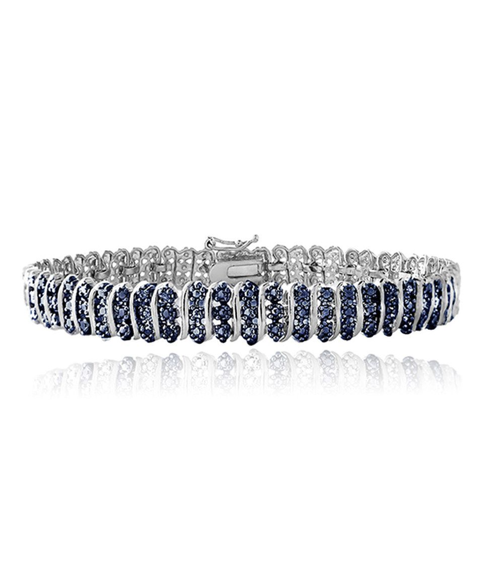 This blue diamond tennis bracelet by designs by fmc is perfect