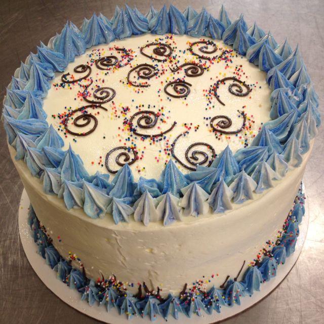 Swirl birthday cake. Blue, green and white cake layers.