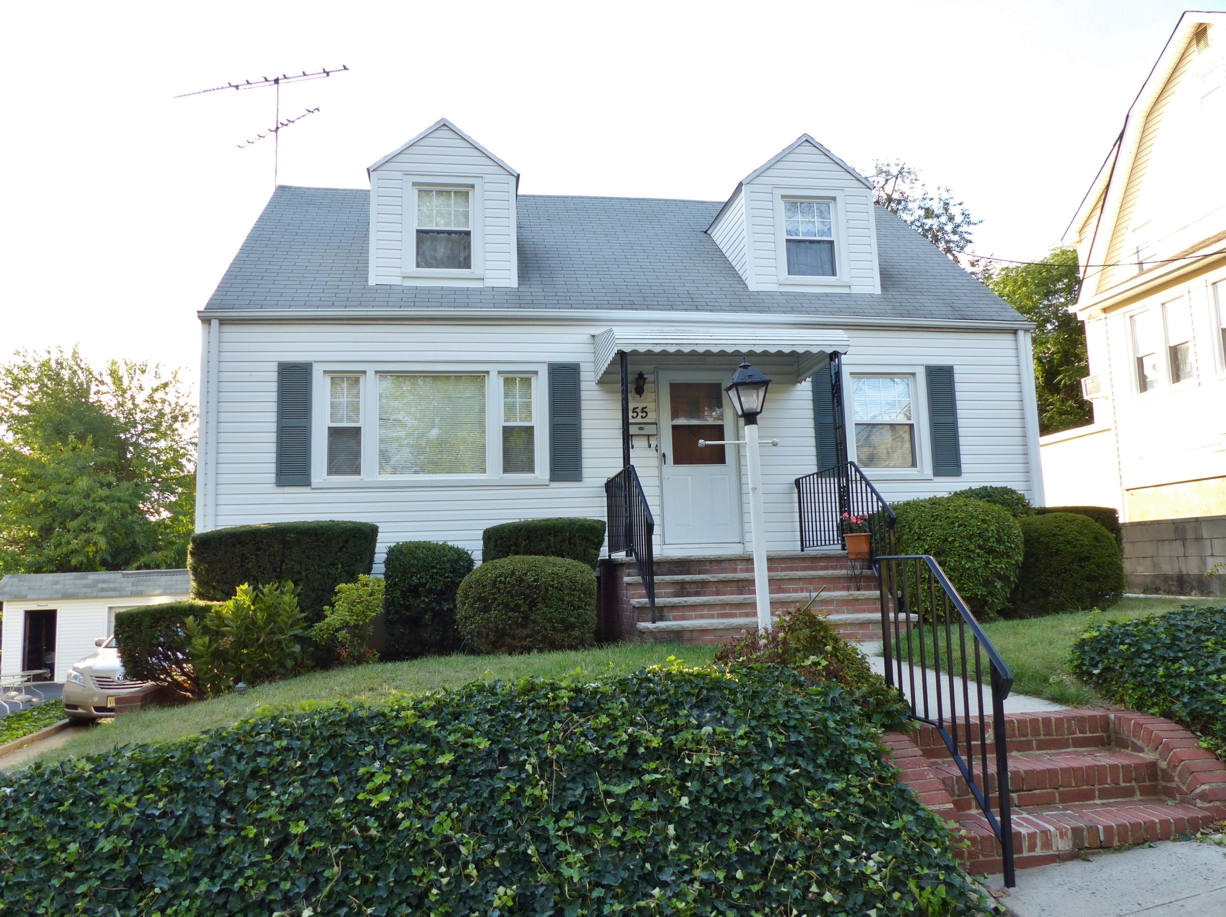 WELL MAINTAINED VINYL SIDED CAPE WITH NEWER ROOF & WINDOWS