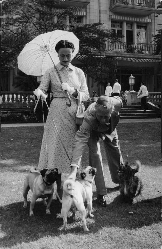 Duke Of Windsor Playing With Dogs While Wallis Duchess Of Windsor